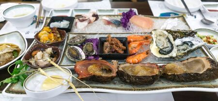 raw seafood platter in jeju island, south korea. Ginseng, sea abalone, shrimp, oysters, and sea squirt.