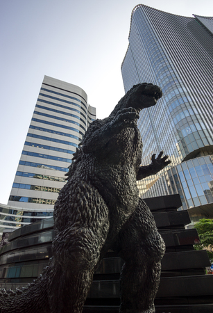 godzilla statue in tokyo amongst the skyscraper and business distrct.
