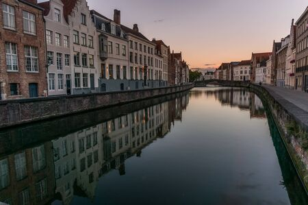 Brugge architecture reflecting off the canal during blue hours after the sunset.