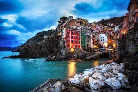 winter sunrise: early morning twilight hours in riomaggiore. Riomaggiore is a small colorful town in Cinque Terre, Italy. Taken during winter season.