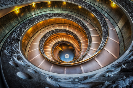 Vatican museum spiral staircase taken with fisheyes lens. Taken in Vatican, Italy