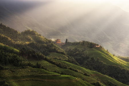 Tian Tou Zhai village viewed from the viewpoint number 1 music from paradise in Longji rice terrace, China. Sunlight over the field