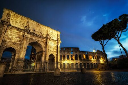 Famous Colosseum and arch of constantine taken at night when the structures are still lit up.