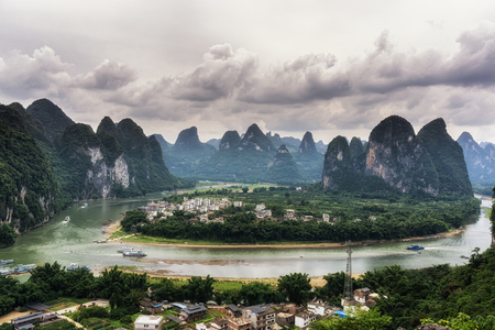 The view of xingping and li river from a nearby mountain in xingping, guangxi, china. Taken during cloudy summer day.