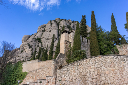Exterior view of Montserrat abbey with the view of the mountain range. Taken in Catalonia, Spain