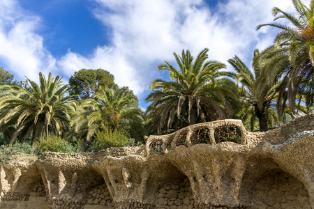 Park guell famous park in Barcelona designed by gaudi. Tall columns and viaducts nearby the entrance of the park.