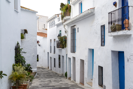 White colored village of Frigiliana in Spain. Narrow streets and alleyways surrounded by white colored houses.