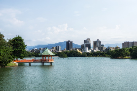 ohori park vermilion pavilion in one of the many islands in the middle of the large pond. Taken in Fukuoka, Japan