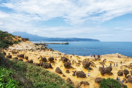 honeycomb and mushroom rocks in Yehliu geopark with crowds Various sedementary rocks along the Northern coast of Taiwan.