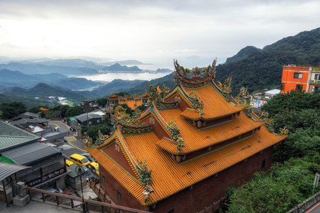 jiufen fushan temple with the view of the ocean and the surroudning mountains. Taken in Jiufen, Taiwan.