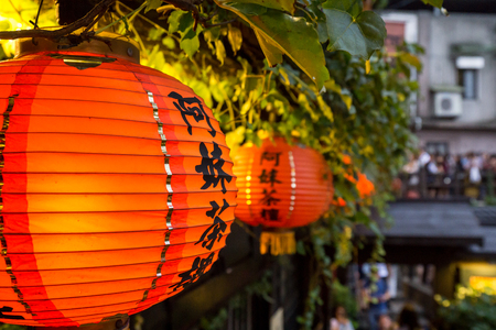 a mei teahouse in jiufen red lanterns hanging near the entrance area. The Chinese character says a mei teahouse. Stock Photo