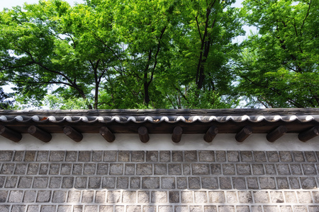 stone wall of deoksugung palace doldam gil road walkway in seoul, south korea Editorial