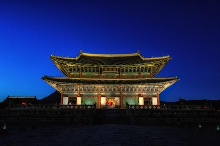 gyeongbokgung palace geunjeongjeon main palace area lit up at night. Famous palace in seoul, south korea