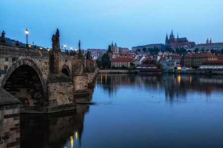 morning view over the charles bridge when the bridge is still lit up.