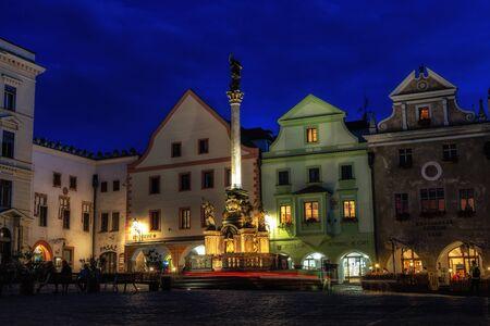 Cesky krumlov fountain and plague column viewed at night. Czech Republic. Taken on august 27th 2019