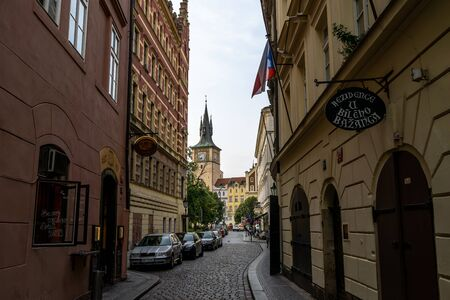 narrow alleyways of prague city in czech republic taken on augst 25th 2019. cars and restaurants line up the small alleyway