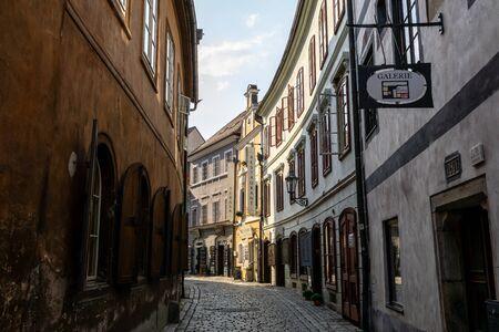 small narrow alleyway in cesky krumlov town with restaurants and galleries. Taken in Czech Republic on August 26th 2019 Redakční
