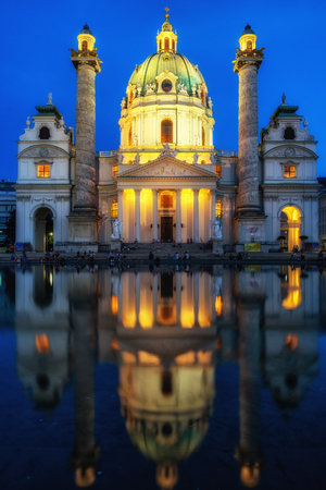 karlskirche or saint charles church in vienna taken at night and after sunset. Famous baroque church located near Kalrsplatz.