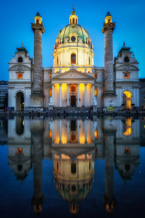 karlskirche or saint charles church in vienna taken at night and after sunset. Famous baroque church located near Kalrsplatz. Reklamní fotografie - 129869050