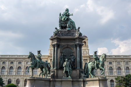 the main statue at maria theresien platz or maria theresia plaza in vienna, austria with the view of natural history museum of vienna. Redakční