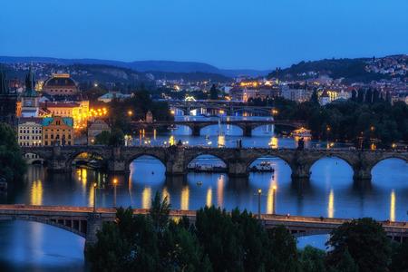 the view of prague bridges and the vltava river viewed from Letna park in Prague, Czech Republic Reklamní fotografie - 129999775