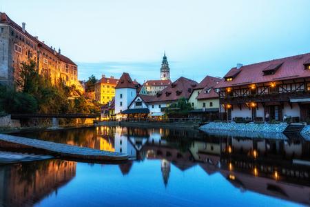 cesky krumlov castle and the town night reflections on the Vltava river. Famous tourist landmark in Czech Republic. Redakční