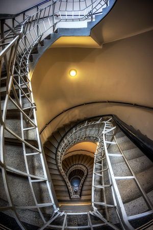 the house at the black madonna or czech cubism museum famous spiraling  lightbulb staircase. 報道画像