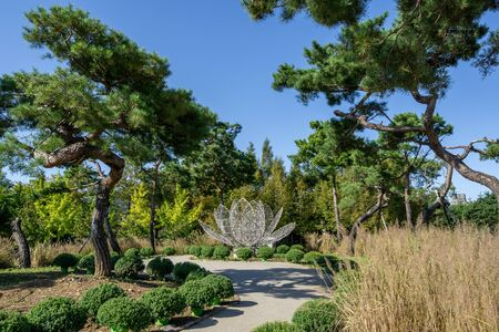 trees and art pieces in semiwon garden taken in Yangpyeong, South Korea Reklamní fotografie