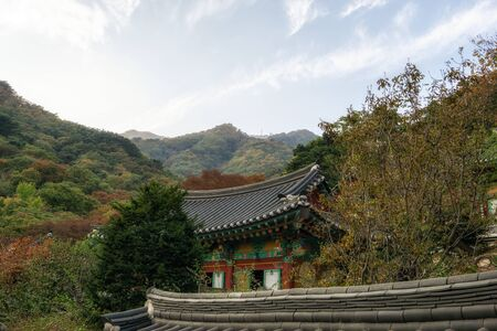 yongmunsa temple surrounded in autumn fall foliage color. Reklamní fotografie
