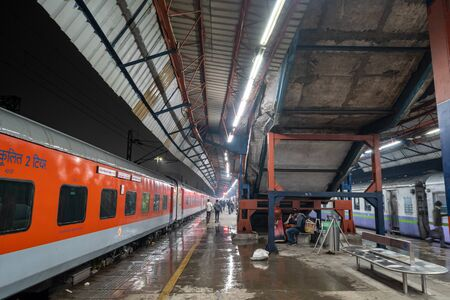 Old delhi train station or delhi junction railway station platforms with people and train waiting. January 13th 2020. New Delhi, India Sajtókép