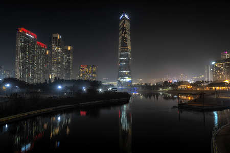 Songdo central park taken at night during autumn season with the view of the iconic hotel in the background. Songdo, Incheon, South Korea. November 13th 2020 Editorial