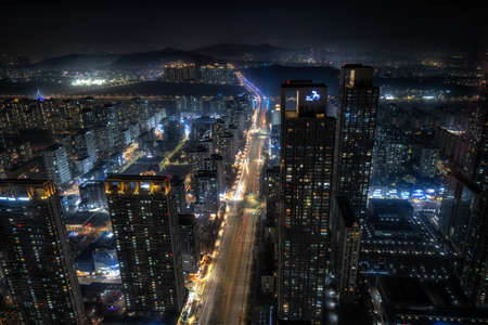 Songdo city view at night with tall apartment buildings and business complexes. Taken in Songdo, Incheon, South Korea on November 13th 2020.