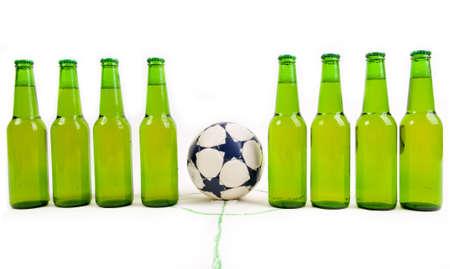 factions: Soccer team of cold beer bottles before soccer game