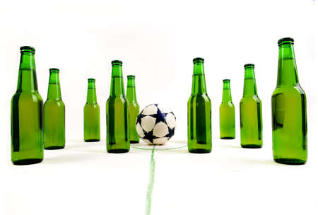 striving: Soccer match with cold, fresh beer bottles