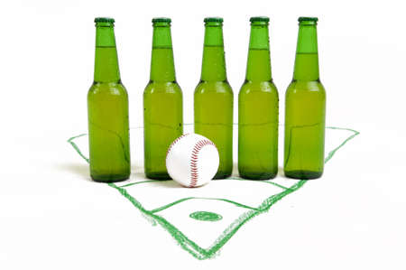 Bottles of fresh beer with baseball ball on pit photo