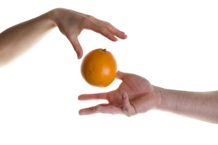 wizardry: Illusion with two hands and orange fruit