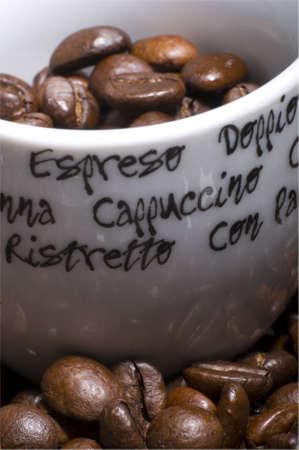 brak: espresso cup filled with coffee  bones