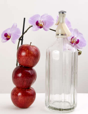 beautycare: Orchids, apples and soda isolated on white and gray Stock Photo