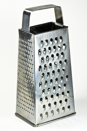 cheese grater on white background photo