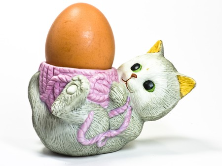 egg on cat eggcup photo
