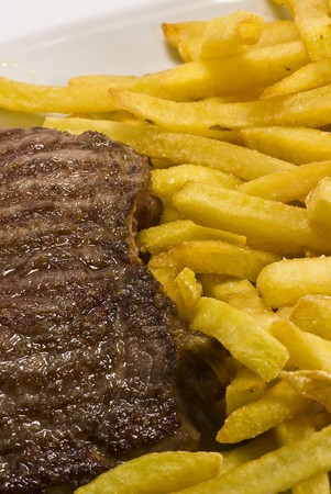 beef steak and french fries photo
