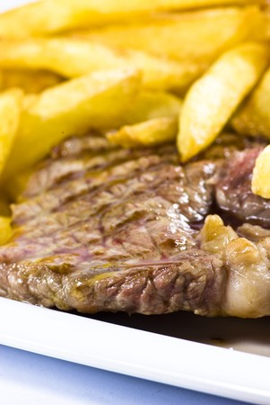 beef steak and fried potatoes  photo