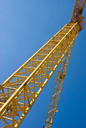 yellow crane against blue sky Stock Photo - 4883766