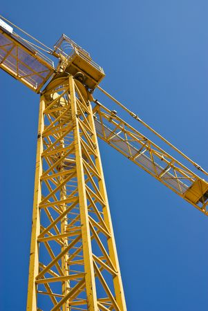 yellow crane against blue sky Stock Photo - 4883808
