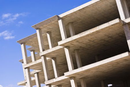 unfinished building: unfinished building against blue sky Stock Photo