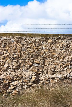 stones wall against blue sky photo