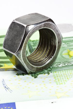 euro screw: euro banknote and metal nut Stock Photo