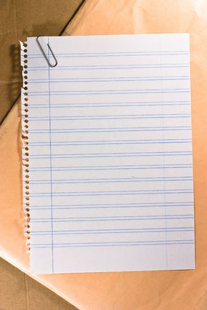 notebook sheet on cardboard texture photo