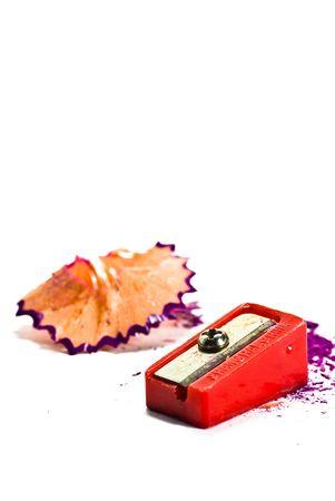 sharpener and pencil shavings on white background photo