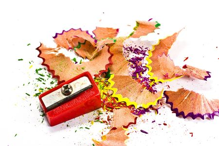 pencil shavings and pencil sharpener on white background photo
